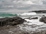 Atlantic ocean, waves crushing on stone coast line. cloudy sky, West coast of Ireland.