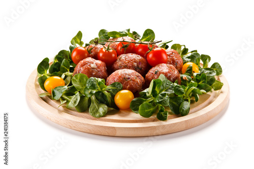 Raw meatballs on cutting board on white background - 241384175