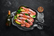 Large grilled shrimp in a frying pan. Tiger prawns. Top view. Free space for your text. On the old background.