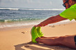 Sportsman stretching on a exotic tropical beach after jogging / exercising. - 241393738