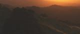 Bushy mountains at hazy sunset - 241396372