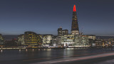 Modern London city skyline at night on River Thames shard building - 241402935