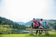 Leinwanddruck Bild - young couple of backpackers near the lake in mountains