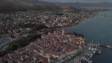 Drone flies over medieval town Trogir, historical center, above churches, old architecture, port and boats. Summer. - 241407717