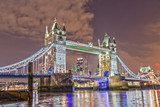 The Tower Bridge in London lights up in the Evening