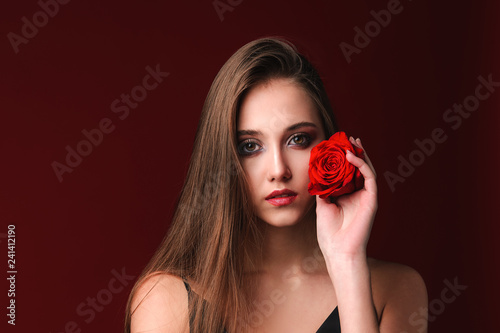 young girl model with flower red rose in studio