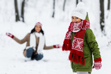 cute child looking at camera and african american mother at background in winter park - 241415145