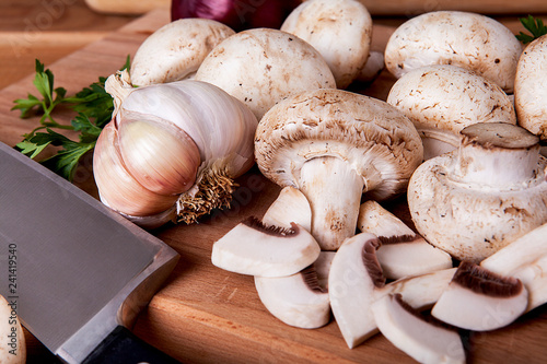Fresh mushrooms on a wooden background. - 241419540