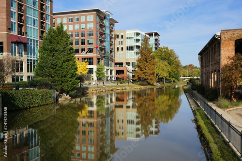 Greenville cityscape - buildings reflecting in Reedy River - 241420368