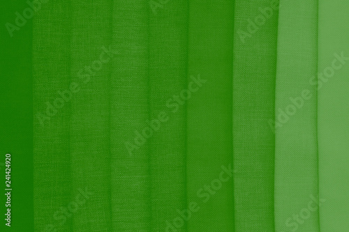 Elegant green textile background. Silk cloth texture. Fabric pattern. - 241424920