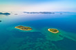 Two lonely stone islands in Zadar archipelago aerial view
