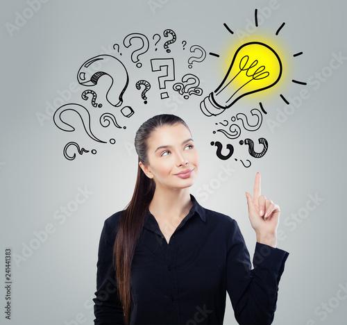Leinwandbild Motiv Girl ideas. Smart woman student with yellow lightbulb. Brainstorm, problem and solution concept