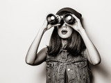 Portrait of young style hipster girl with binoculars . Image in black and white color style - 241442508