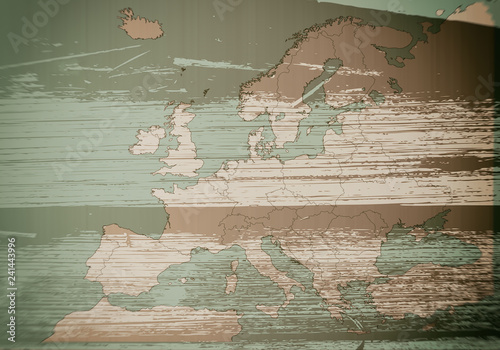 Map of Europe on a wooden background, texture, blurred image © Milan