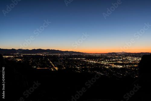 Predawn mountaintop view of sprawling west San Fernando Valley neighborhoods in Los Angeles, California. - 241453740