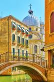 Venetian canal with bridge - 241456140
