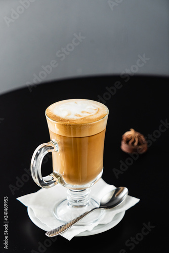 hot cappuccino on the black table - 241469953