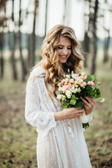 Beautiful bride with wedding flowers bouquet.