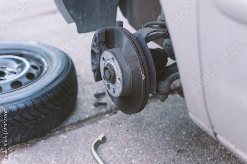 mechanic changing a wheel of a car - 241473597