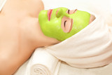 Beautiful happy woman in the spa making face mask treatment.selective focus - 241482541