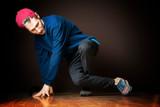 attractive male street dancer perform break dance footwork b