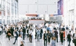 Leinwanddruck Bild - Crowd of people walking on a trade show in london