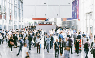 Crowd of people walking on a trade show in london