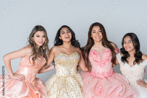 obraz lub plakat Four Hispanic Girls In Quinceanera Dresses