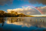 Fototapeta Tęcza - rainbow over the lake on an autumn evening © Mike Mareen