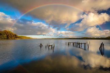 rainbow over the lake on an autumn evening