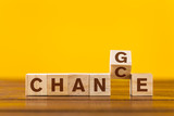 Change concept. Wooden letters on a yellow background - 241515177