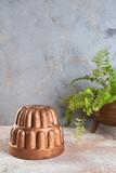 Vintage copper mold on a concrete background. - 241516111