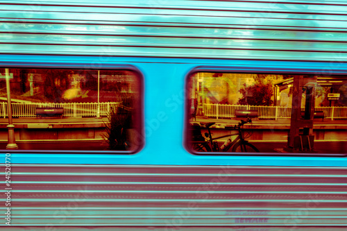 train speeding past station