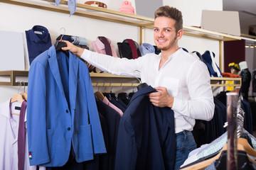 Cheerful man purchasing jacket
