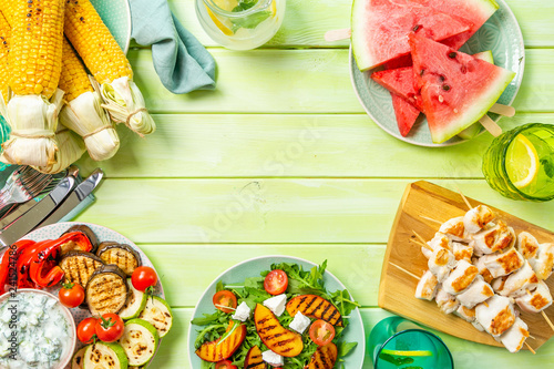 mata magnetyczna Summer bbq party concept - grilled chicken, vegetables, corn, salad, top view, copy space