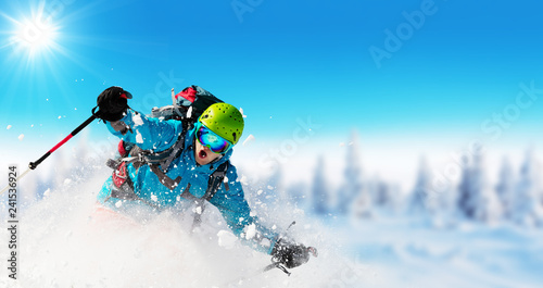 Young man skiing on piste - 241536924