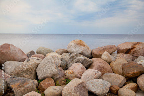 A pile of stones on the lake. - 241538392