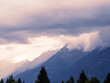 Mountain range with stormy clouds above - 241548713