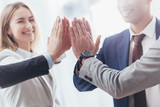 cropped shot of professional successful business team giving high five in office - 241556151