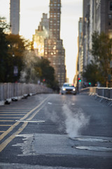 Smoke in the street of New York with car on background © matteozin