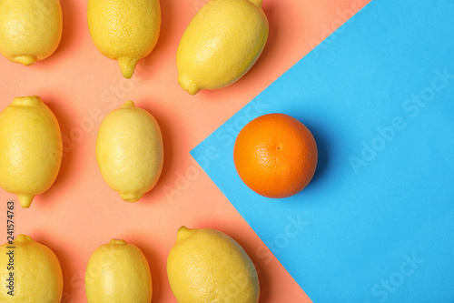 Orange in front of lemons on color background, top view. Be different - 241574763