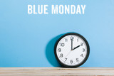 Blue Monday words on blue colored background with clock - 241575171