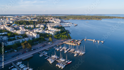 Beautiful view of harbor and boats. Helsinki city at sunset. Summer panorama.