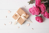 gift, flowers and hearts on a colored background. Background to Valentine's Day or Mother's Day. Holiday, give. International Women's Day. - 241580912