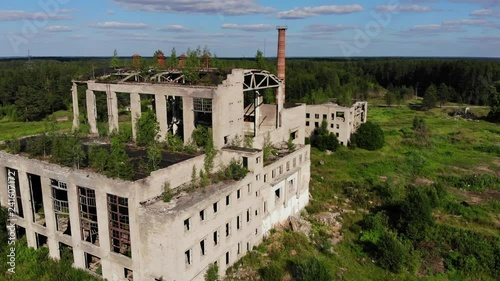 Abandoned factory exterior in Russia. Old industrial building for demolition.