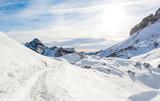 Trail running through spectacular winnter mountain landscape.