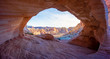 Arch Canyon window to the Valley with the bluesky and colorful sandstone reflection with sunray