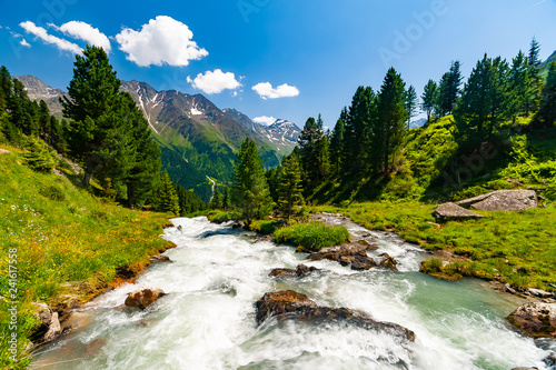Beautiful summer landscape of mountains and fresh water in river, Tyrol Alps, Austria - 241617558