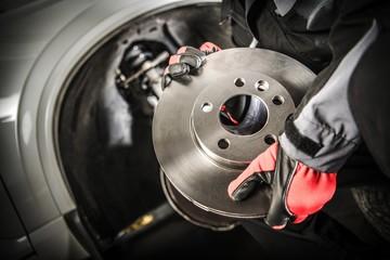 Car Mechanic with Brake Disc © Tomasz Zajda