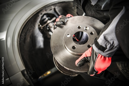 Car Mechanic with Brake Disc - 241627534